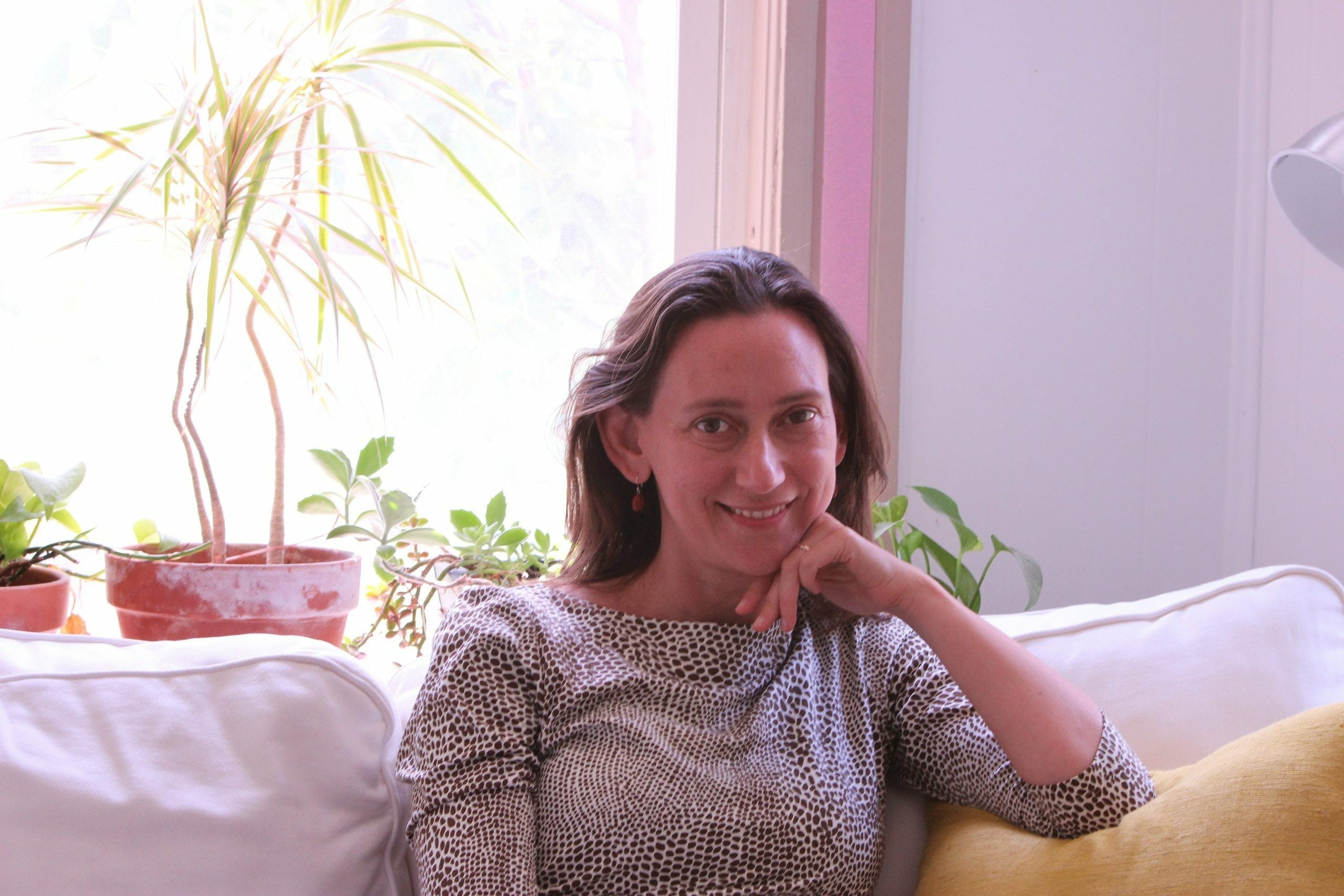Nadia Colburn sitting on couch discussing mindful writing classes