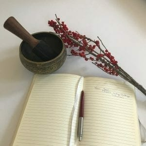 book and singing bowl for mindful writing challenge
